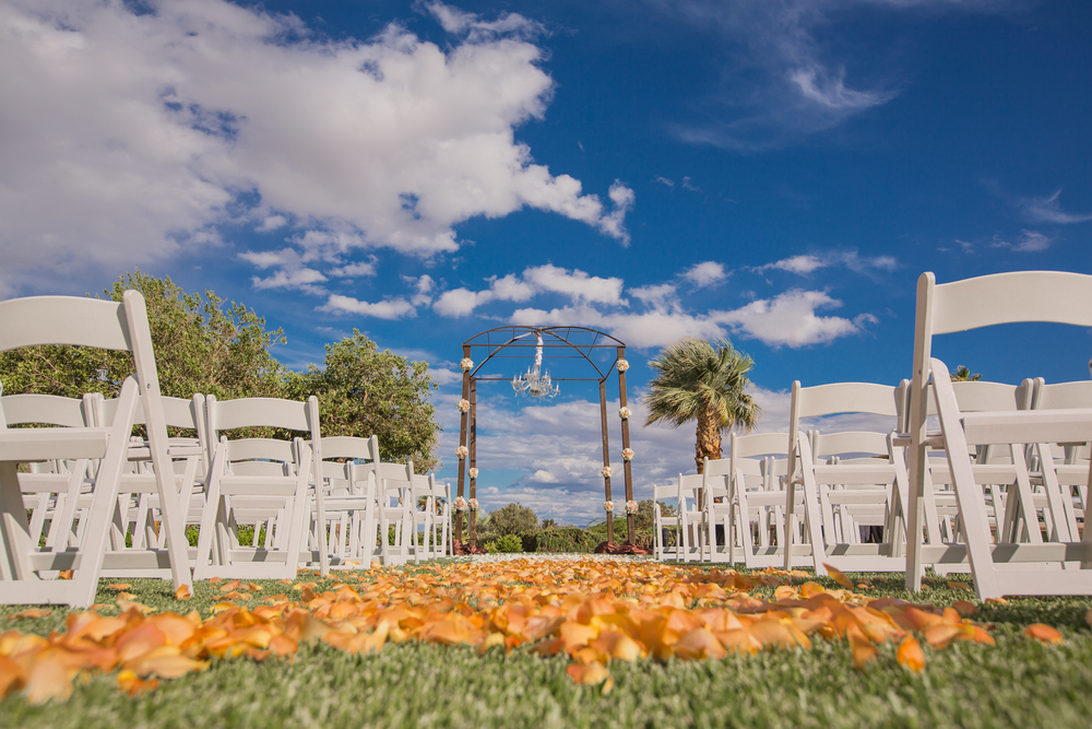 The rain stopped and the sun appeared just in time for Michelle & Michael's ceremony by the water. Las Vegas Wedding at Siena Golf Club  |  Photography by Ella Gagiano  | Floral and Decor by Naakiti Floral  |  Las Wedding Planner Andrea Eppolito
