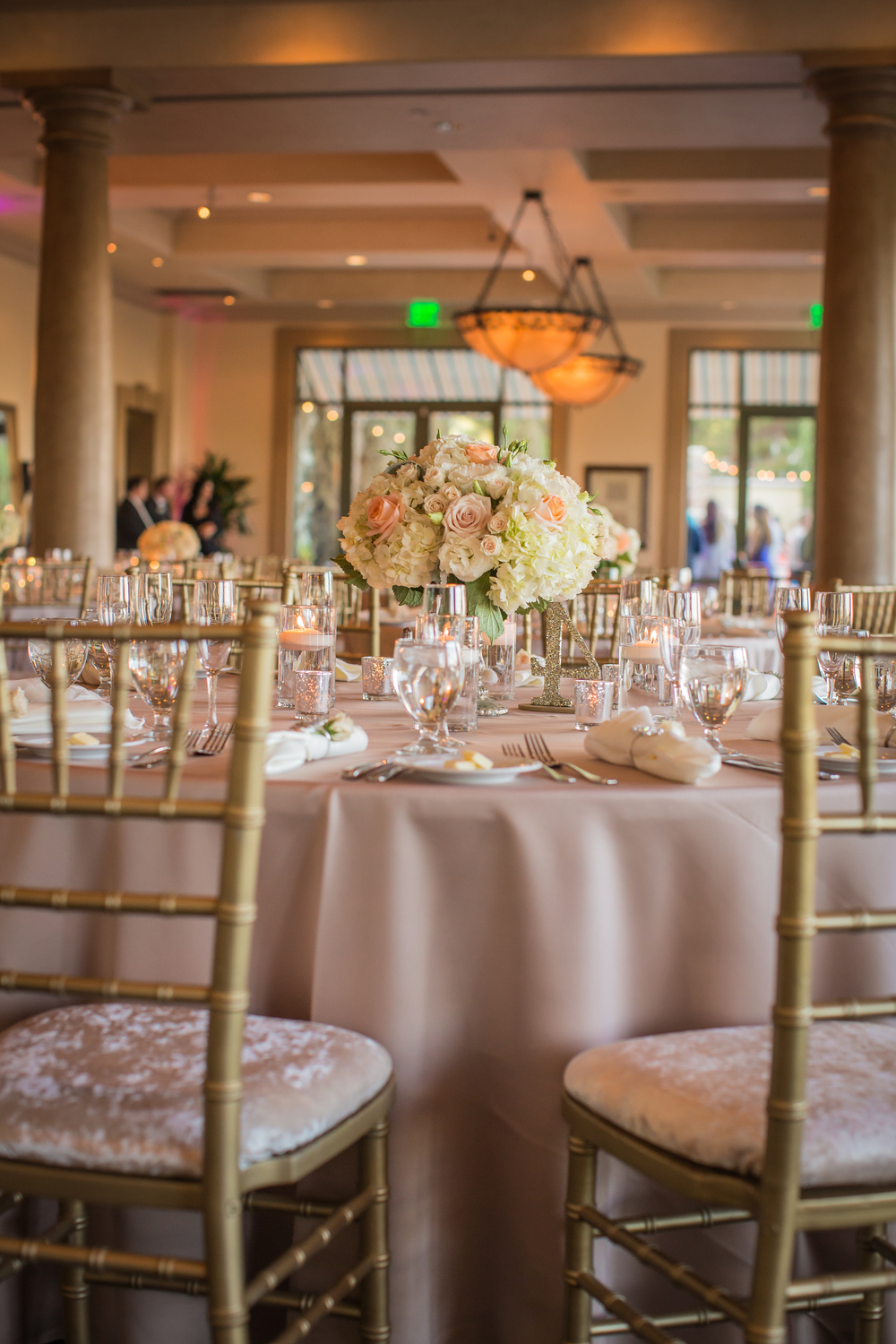 Gold Chiavari Chairs, crushed velvet seat cushions, and blush linens created a neutral, romantic environment that allowed our peach roses to pop.  Las Vegas Wedding at Siena Golf Club  |  Photography by Ella Gagiano  | Floral and Decor by Naakiti Floral  |  Las Wedding Planner Andrea Eppolito