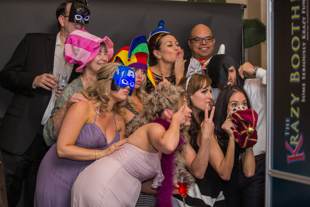 The Krazy Photo Booth included LED super hero masks, hats, and costume pieces.  There was a line around the room! Las Vegas Wedding at Siena Golf Club  |  Photography by Ella Gagiano  | Floral and Decor by Naakiti Floral  |  Las Wedding Planner Andrea Eppolito