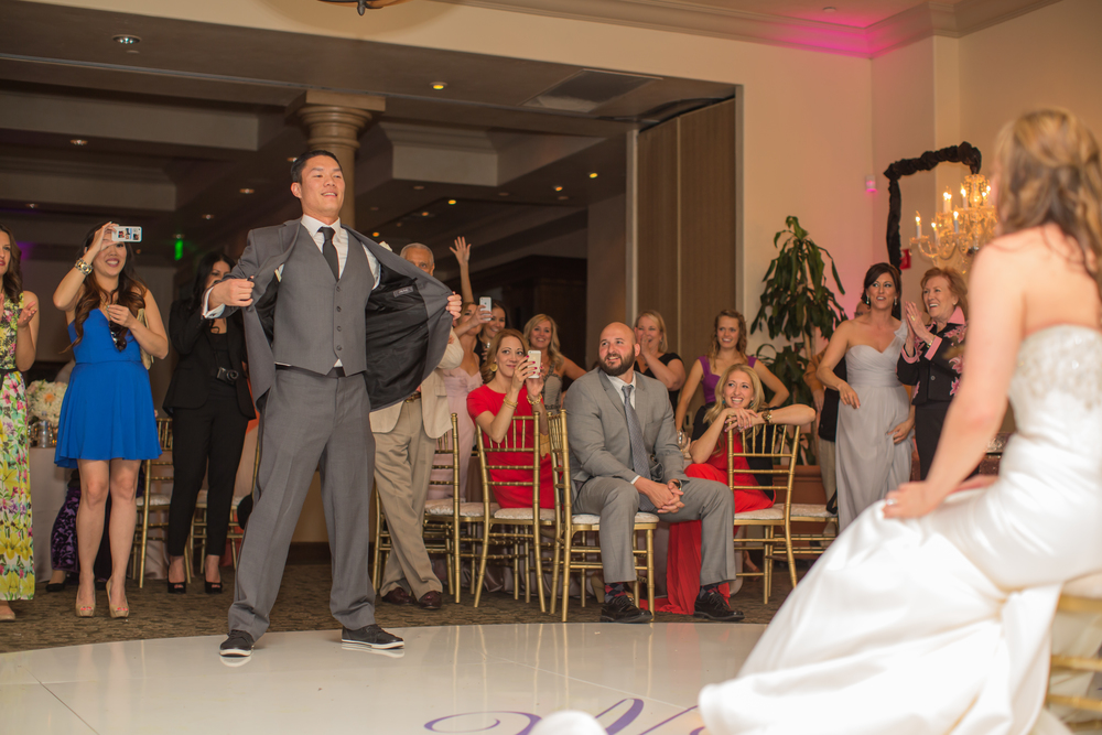 The groom took the floor, providing a show for his new bride and their guests. Las Vegas Wedding at Siena Golf Club  |  Photography by Ella Gagiano  | Floral and Decor by Naakiti Floral  |  Las Wedding Planner Andrea Eppolito