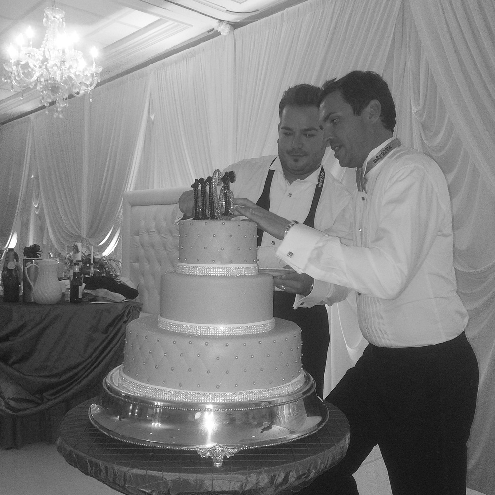 Cutting the cake.  Marek and Rocco - Mr. & Mr. Destination Wedding Planner Chicago & Las Veags: Andrea Eppolito