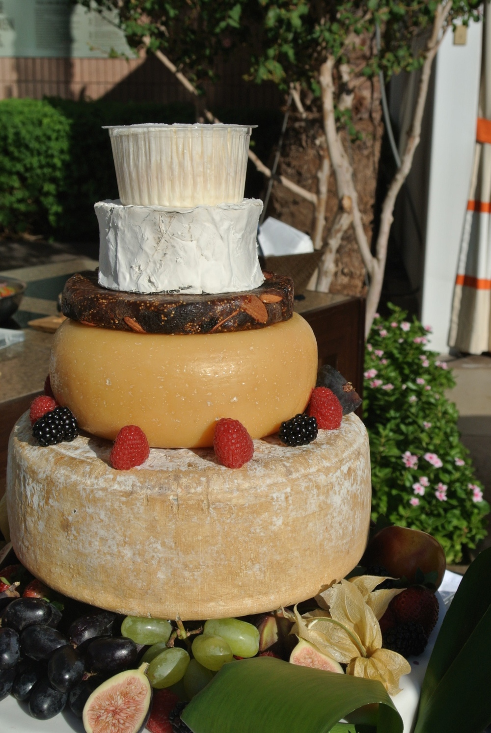 Cheese Cake! I love cheese. I love cake. And so does the groom, leading us to work with the chef to create this wedding style cheese display accented with fresh fruits and florals.   Las Vegas Wedding Planner:   Andrea Eppolito Events  | Wedding Venue:   Mandarin Oriental Las Vegas