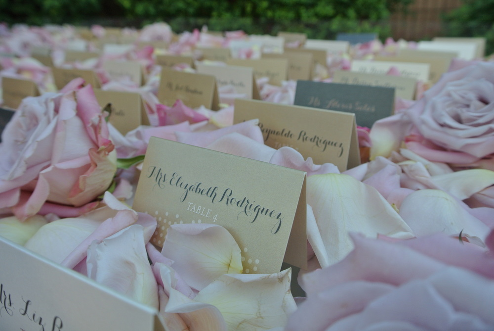 Escort Cards in various shades of ivory, gold, and platinum were created by  Paper & Home , and nestled lovingly into the rose petals set up by  Naakiti Floral .   Las Vegas Wedding Planner:   Andrea Eppolito Events  | Wedding Venue:   Mandarin Oriental Las Vegas