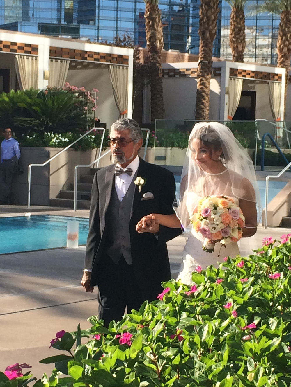 The bride's father proudly walked her down the aisle.   Las Vegas Wedding Planner:    Andrea Eppolito Events    |  Wedding Venue:    Mandarin Oriental Las Vegas