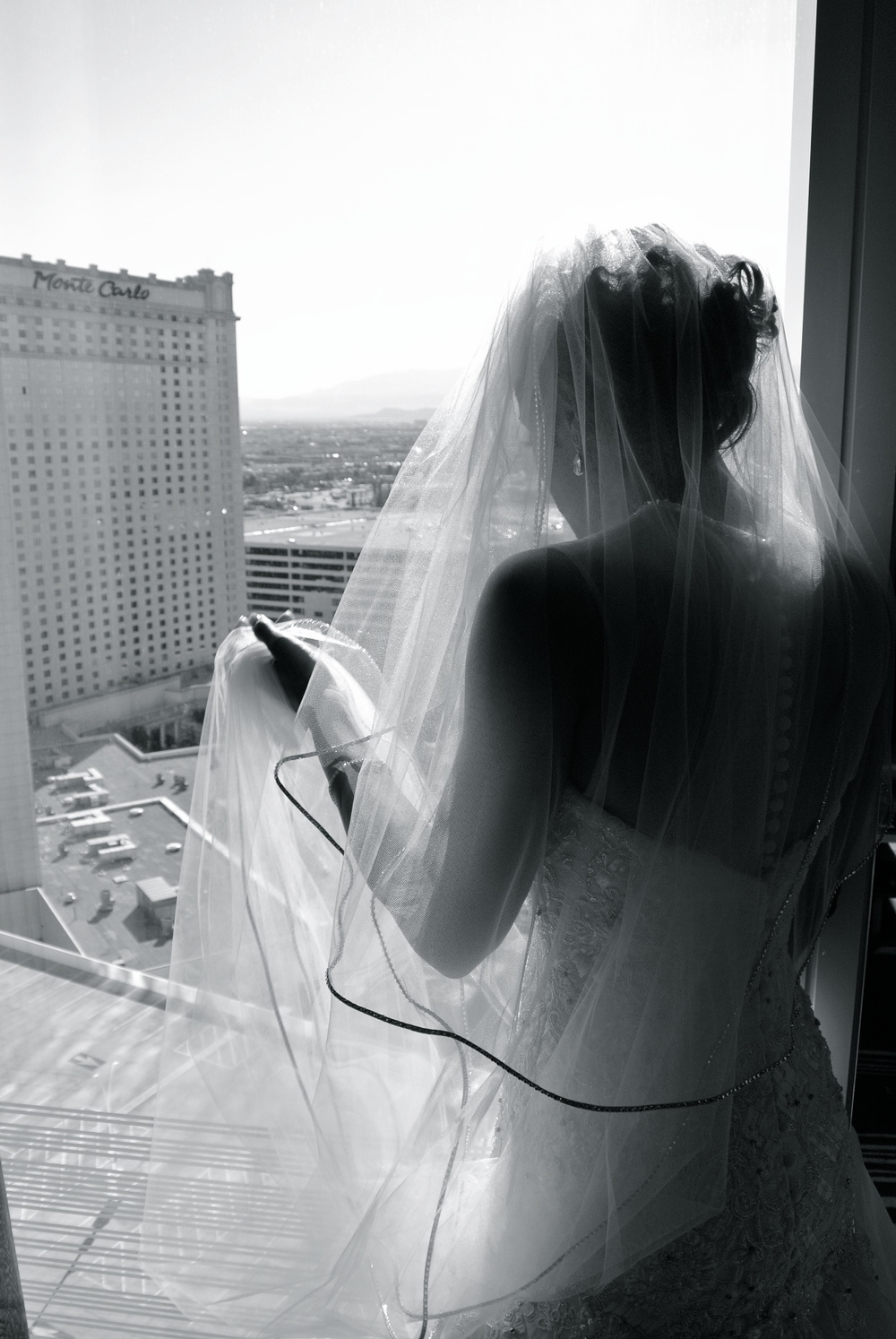 The bride watched from her penthouse suite as the pool deck was transformed into the ceremony.     Las Vegas Wedding Planner:    Andrea Eppolito Events    |  Wedding Venue:    Mandarin Oriental Las Vegas