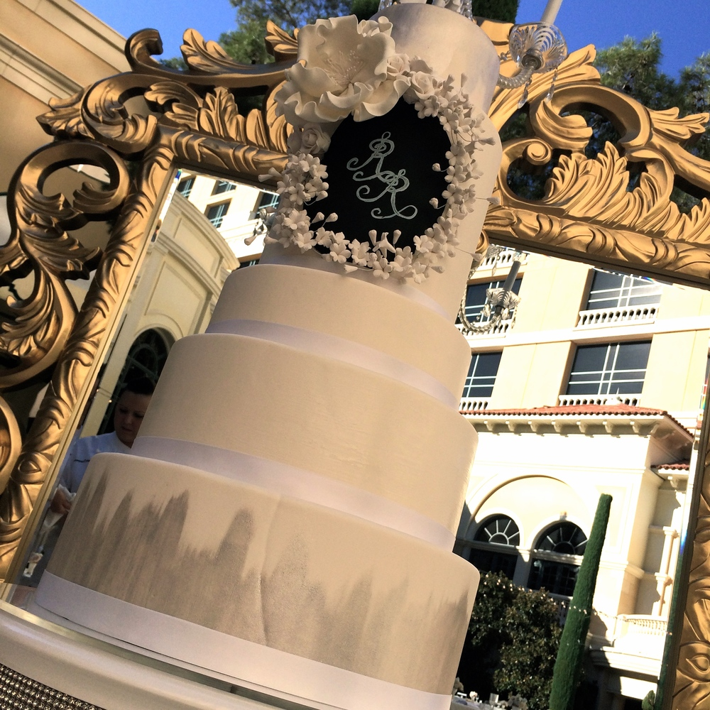 White and Silver Wedding Cake with Chalk Board Detail and Magnolia Sugar Flowers.  Gold Mirror.    Las Vegas Wedding Planner Andrea Eppolito  |  Wedding at Bellagio Las Vegas