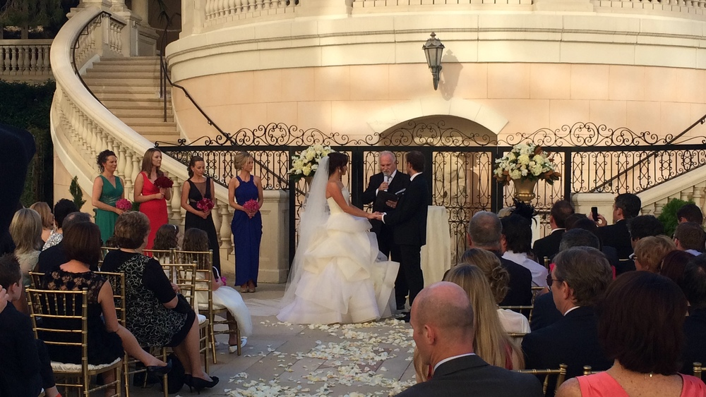 Wedding Ceremony at Bellagio Las Vegas.  I love the ornate gate and lattice work behind them, and the staircases just look so romantic.   Las Vegas Wedding Planner Andrea Eppolito  |  Wedding at Bellagio Las Vegas