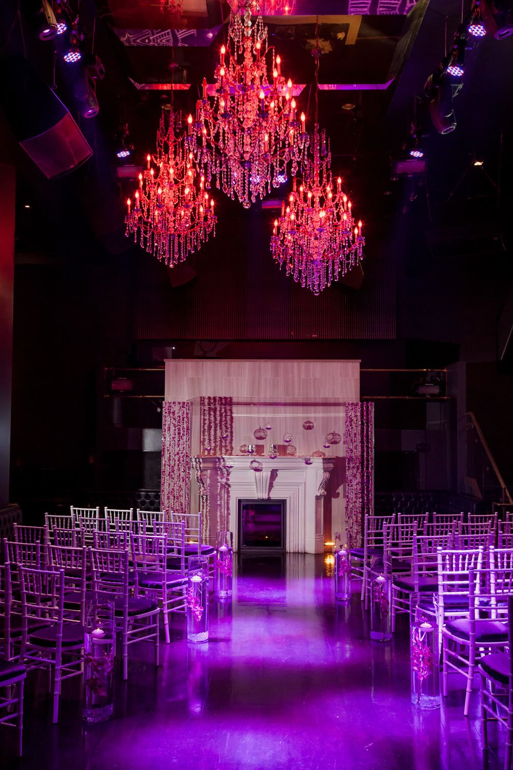 Dramatic lighting turned Chateau Nightclub into a romantic setting for the wedding ceremony.