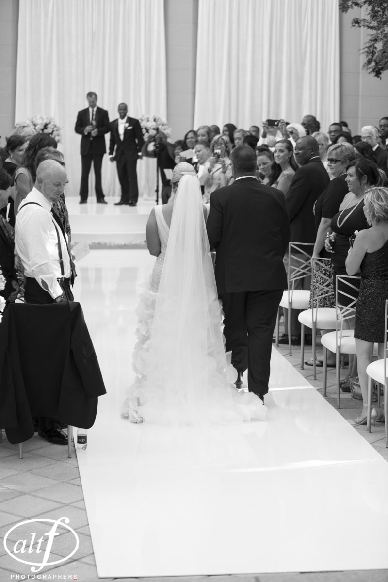 Bride being given away by her father at a luxury wedding in Las Vegas.