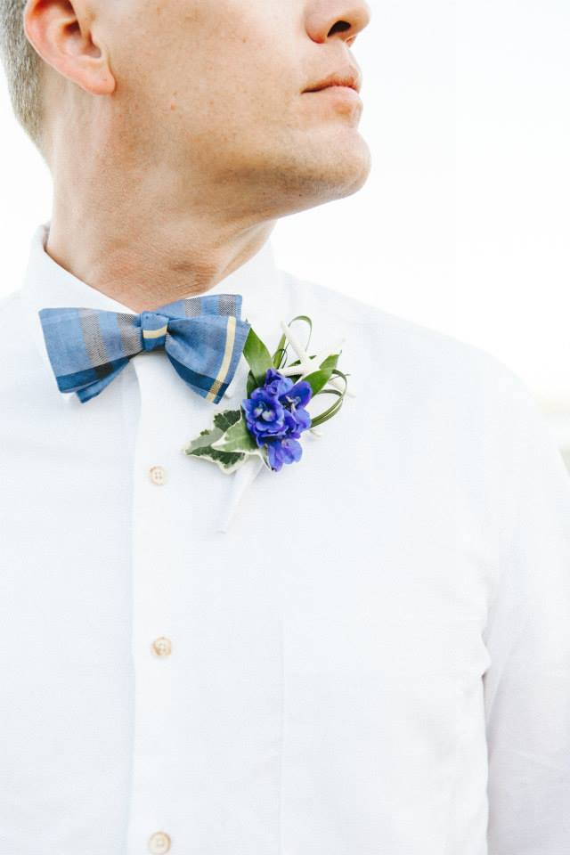 A plaid bowtie and small blue flower were all this groom needed at his beachside wedding in Coronado just outside of San Diego.  Phillip Safarik.  August 2014.   Las Vegas Wedding Planner Andrea Eppolito  |    Photo by  www.burlapandblossom.com