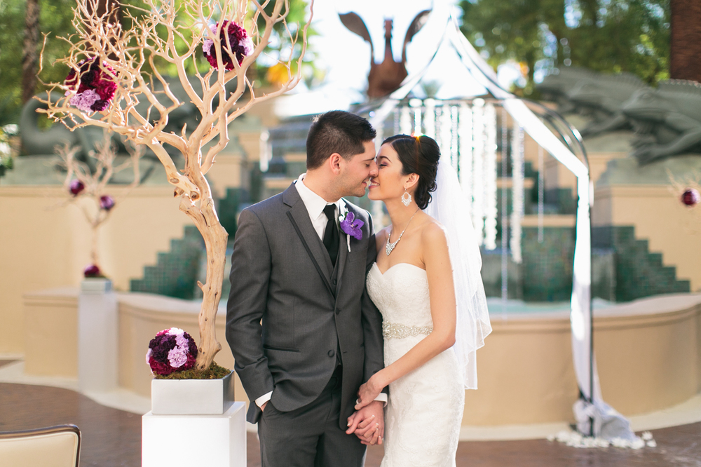 Featured on Style Me Pretty:     Katherine & Jared wanted a destination Las Vegas wedding that was both romantic and sweet.  The Four Seasons was the ideal location for their ceremony and reception.  With views of the Las vegas Strip and the timeless decor of the Four Seasons, Katherine was able to play up her colors of purple, lavender, and orchid...Months before it became the color palette of the year!  And for the foodies who like to keep things sweet, the culinary team certainly didn't disappoint!     Wedding at  Four Seasons Las Vegas   |  Las Vegas Wedding Planner  Andrea Eppolito   |  Photography by  Meg Ruth   |  Dress by La Sposa  |  Tux by Vera Wang Men  |  Flowers by  Naakiti Floral   |  Rentals and Decor by  Sit on This Inc.
