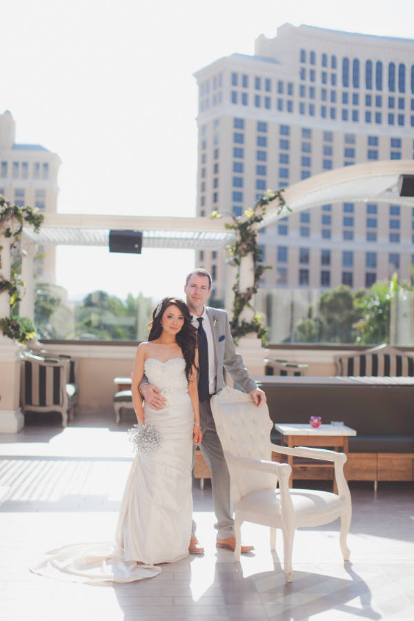 Featured on The Knot:   This couple wanted a wedding unlike any seen in their native Canada!  They tasked me with finding a venue that was totally unique, that offered a view of The Strip without feeling like it was too Vegas-inspired, and asked for details that dazzled.  They wanted a modern, clean, and chic wedding that also gave a nod to the bride's Chinese Heritage.  What we came up with was a palette of neutral colors that we set against the red lighting of Chateau Nightclub, chandeliers under the legs of the Eiffel Tower of Paris Las Vegas, a killer same-day edit of their wedding photos, and Chinese Lion Dancers.      Wedding Gown by Anais Collezione | Bridal Shoes by  Jimmy Choo  | Bouquet by Ky Kamperfeld | Photography by  Adam Trujillo  | Hair & Make Up by  Your Beauty Call  | Lion Dancers by The Las Vegas Kung Fu Academy | Venue of  The Paris Hotele l -  Chateau Nightclub & Gardens  | Decor by  Naakiti Floral