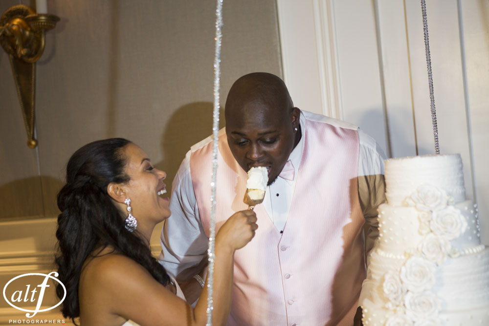 Bride feeds the groom.  Las Vegas Wedding Planner Andrea Eppolito