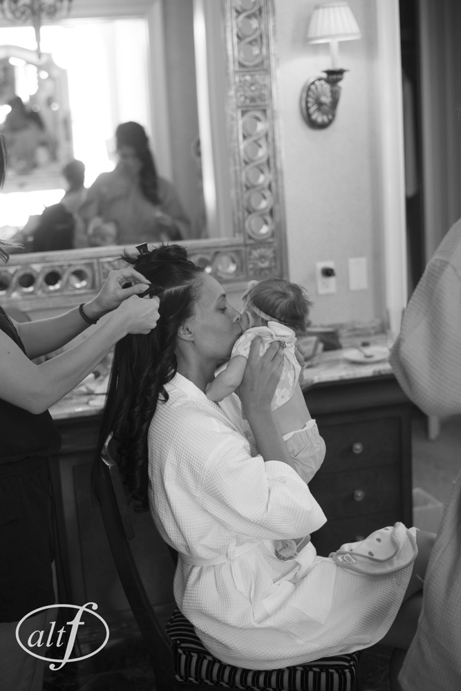The bride and her baby getting ready for the wedding. Las Vegas Wedding Planner Andrea Eppolito  |  Venue:  Caesars Palace  |  Photo by www.altf.com