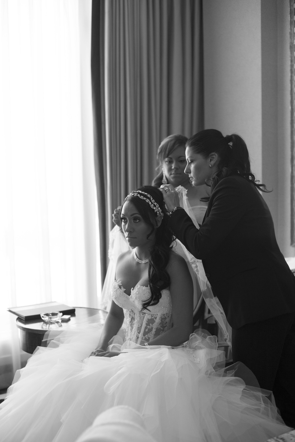 Las Vegas Wedding Planner Andrea Eppolito helps a bride get ready