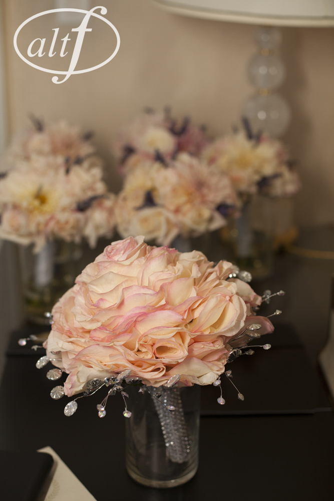 The Glamalia is one large rose bouquet made from the petals of dozens of other roses.  The bride's bouquet featured pale pink petals with bright pink tips, a crystal hand wrap, and crystal accents around the edges.  Las Vegas Wedding Planner Andrea Eppolito helps a bride get ready