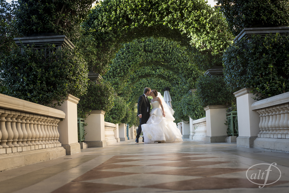 The Bride & Groom Kiss in the Gardens