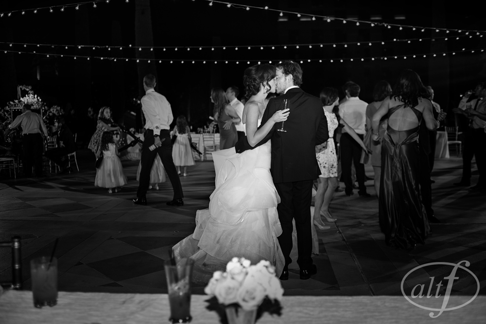 The Bride and The Groom Kiss Under the Lights