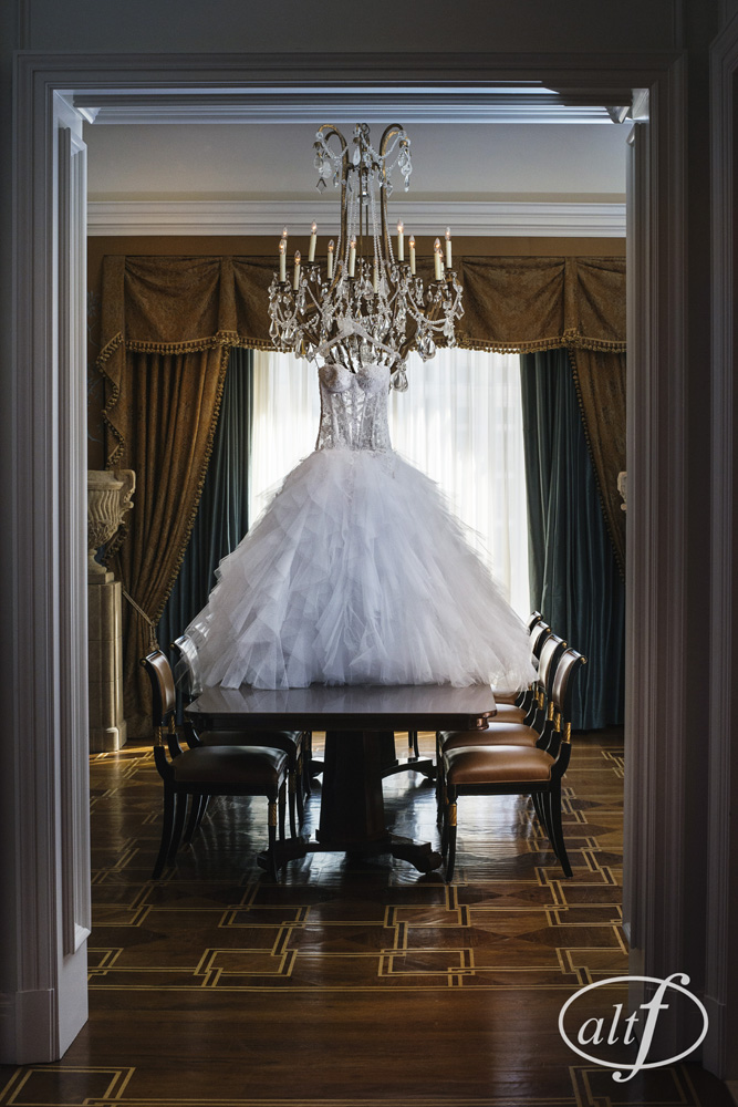 Lace and Tulle Wedding Gown by P'Nina Tornai.  The ballgown shape was tradition, speaking to the bride's desire to have a princess moment, while the see through bodice and lace cuts were modern and sexy, showcasing a completely different side of the bride.  Megan Bridges.  September 2014.  Photo by Alt F Photography.