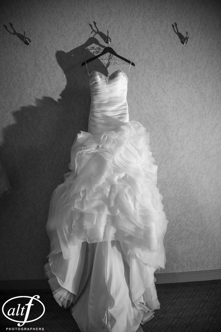 Spring calls for soft and romantic wedding dresses.  This bride selected a Demetrios gown with ruffles and raw edges in a light weight chiffon.  The neckline was customized for her, cut into a sweetheart shape and lined with crystal and pearl bead work.  Amy Noe.  April 2014.  Photo by Alt F Photography.