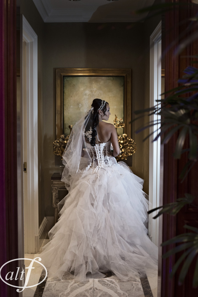 P'Nina Tornai gowns are as detailed and intricate from the back as they are from the front.  Megan Bridges.  September 2014.  Photo by Alt F Photography.