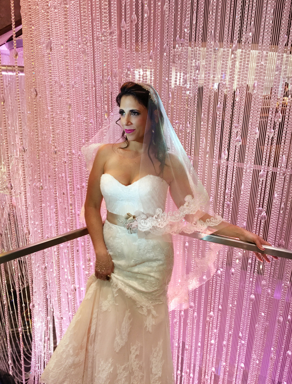 Oh, what it must be like to wear a sample size!  When this bride decided to run off and elope in Las Vegas, she walked into her local salon and purchased this pale pink Watters wedding gown right off the rack.  This behind the scenes photo was snapped by John Michael Cooper on an iPhone of all things!