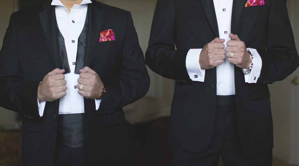 The grooms were totally free to be themselves, with Rocco embracing his laid back style with an open bowtie.  Marek's bowtie was finished tight and high.  Destination Wedding Planner Andrea Eppolito  |  Photo by Antonio Abrego | Gay Weddings
