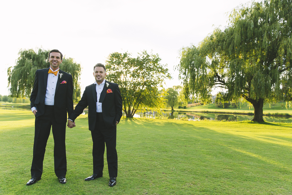 The grounds of the Oak Lawn Country Club provided gorgeous green hills and landscaping for the couple's formal portraits. Destination Wedding Planner Andrea Eppolito  |  Photo by Antonio Abrego | Gay Weddings