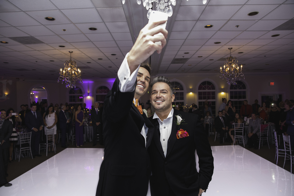 And they sealed their vows with a selfie! Rocco has been named as one of Las Vegas' most influential tweeters, so naturally they needed to document their union with a selfie. Destination Wedding Planner Andrea Eppolito  |  Photo by Antonio Abrego | Gay Weddings