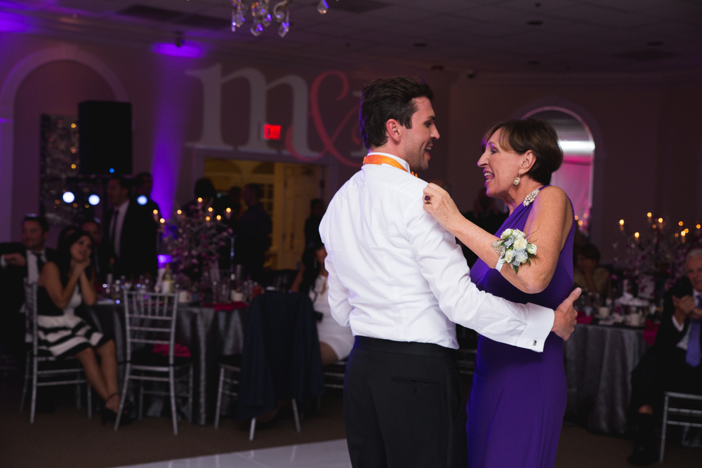 "Groom Marek and his mother cut up the dance floor to Cindy Lauper's ""True Colors"". Destination Wedding Planner Andrea Eppolito  