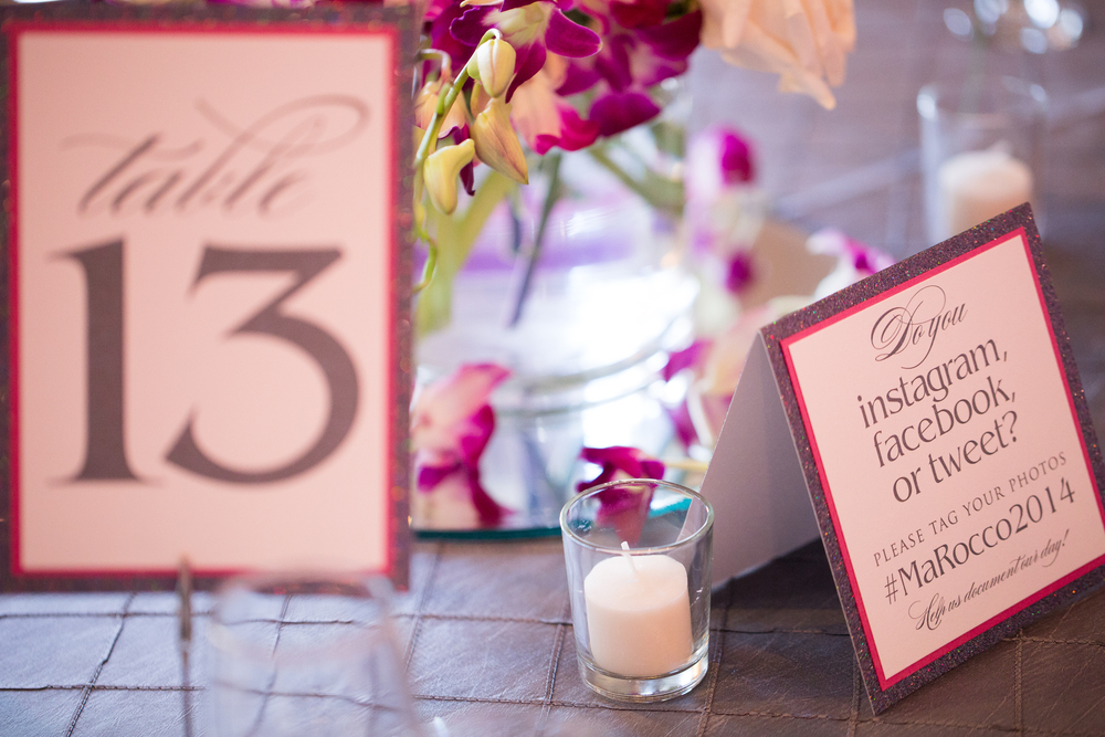 This social couple kept things organized online with their hashtag #MaRocco2014, which was printed on table cards.  All of the stationery featured a platinum glittered border beneath fuchsia and white card stock. Destination Wedding Planner Andrea Eppolito  |  Photo by Antonio Abrego | Gay Weddings