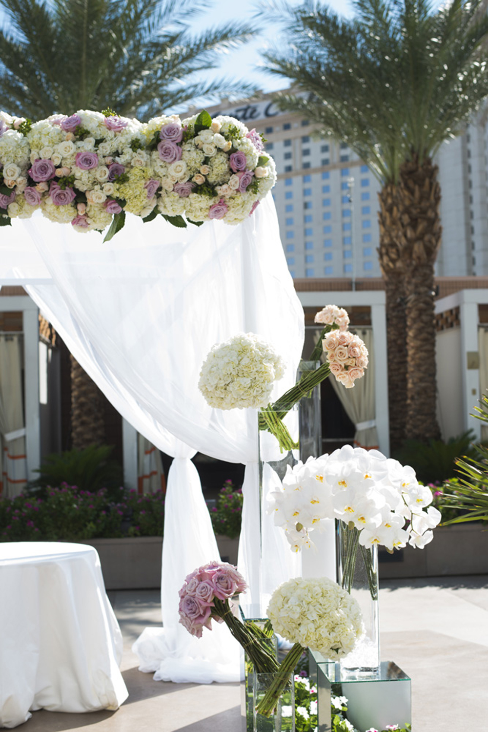 The white canopy and drape was off set by bursts of color and pastel florals.   Las Vegas Wedding at   Mandarin Oriental   |  Photo by  Altf Photography   |  Floral and Decor by  Naakiti Floral   |  Las Vegas Wedding Planner  Andrea Eppolito