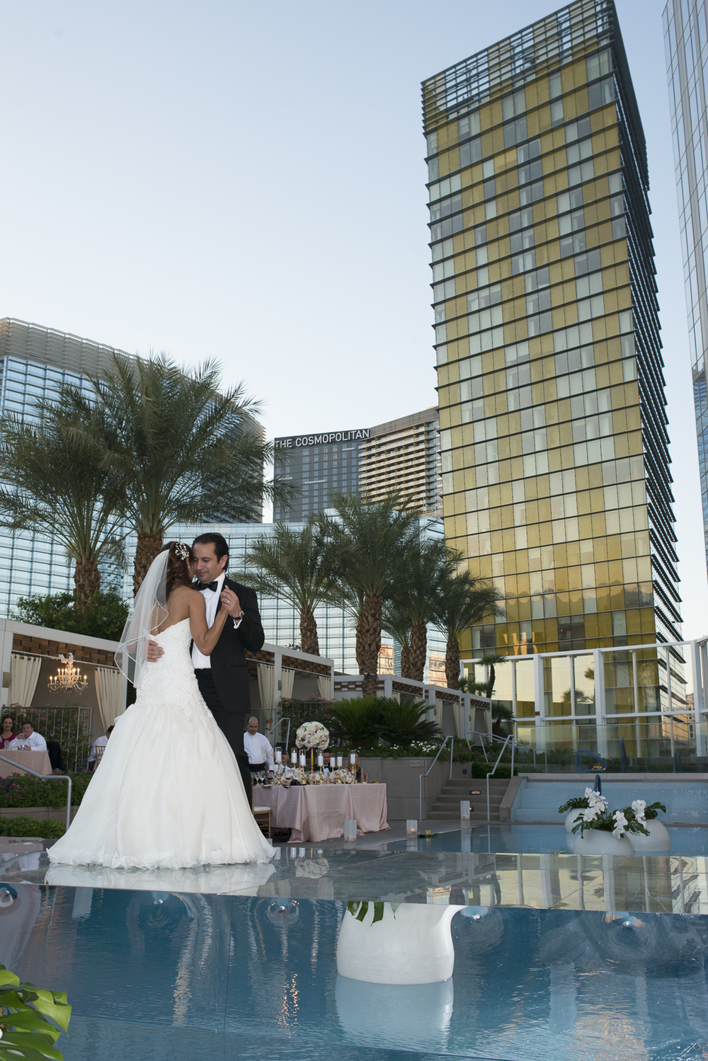 The mirrored dance floor floated above the water, giving the bride and groom a beautiful platform for their first dance.   Las Vegas Wedding at   Mandarin Oriental   |  Photo by  Altf Photography   |  Floral and Decor by  Naakiti Floral   |  Las Vegas Wedding Planner  Andrea Eppolito