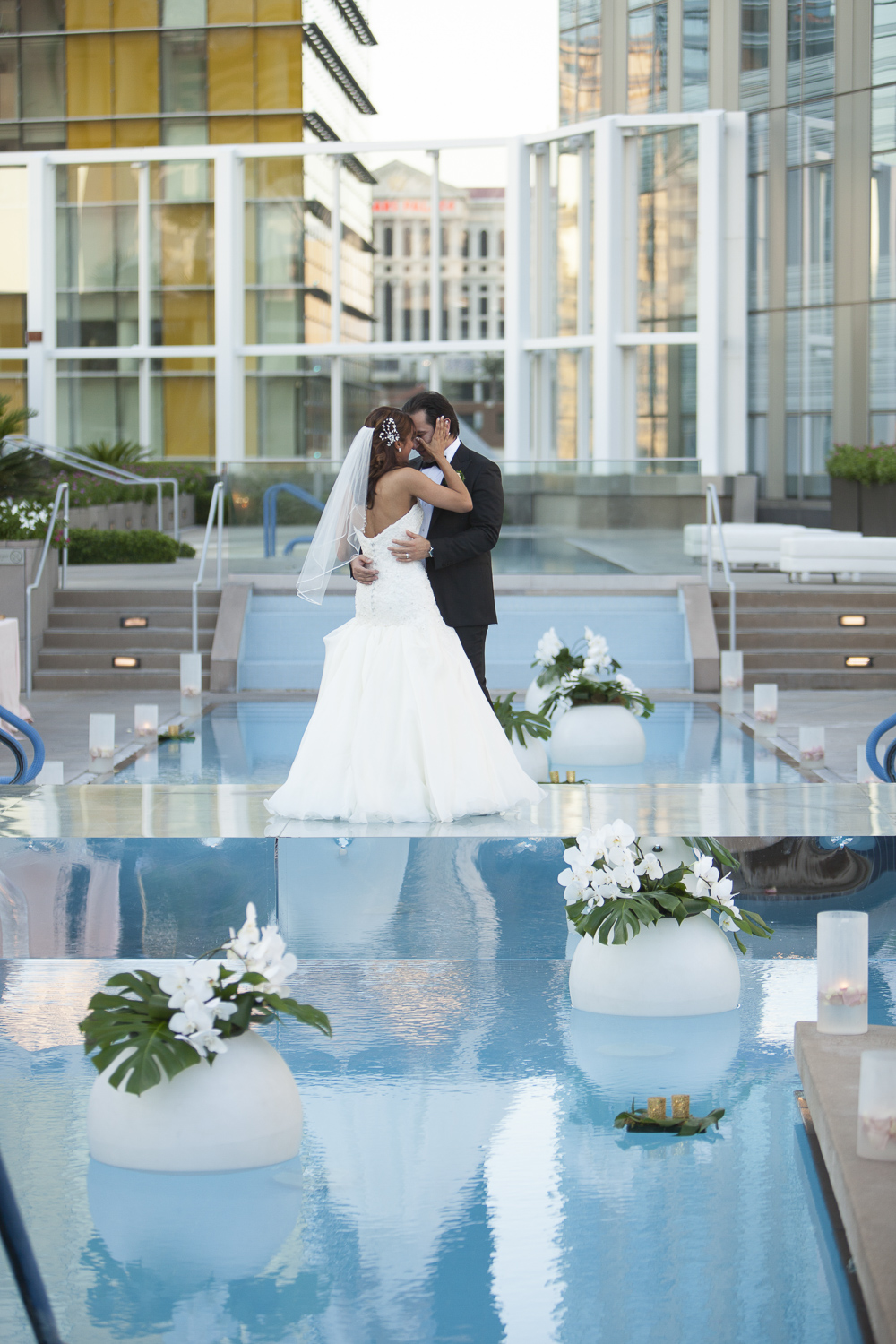 By placing Jess and Juan in the center of the pool, they were able to enjoy their first dance feeling as if they were the only two people in the world.   Las Vegas Wedding at   Mandarin Oriental   |  Photo by  Altf Photography   |  Floral and Decor by  Naakiti Floral   |  Las Vegas Wedding Planner  Andrea Eppolito