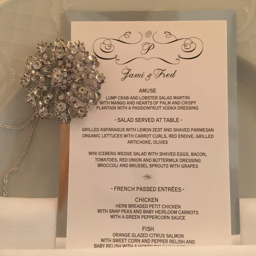 The menu cards were designed and produced by Alligator Soup.  Each broach from the bride's bouquet was retrieved, strung on a necklace, and presented to the women in attendance as a moment from the evening.  Photo by  Andrea Eppolito .
