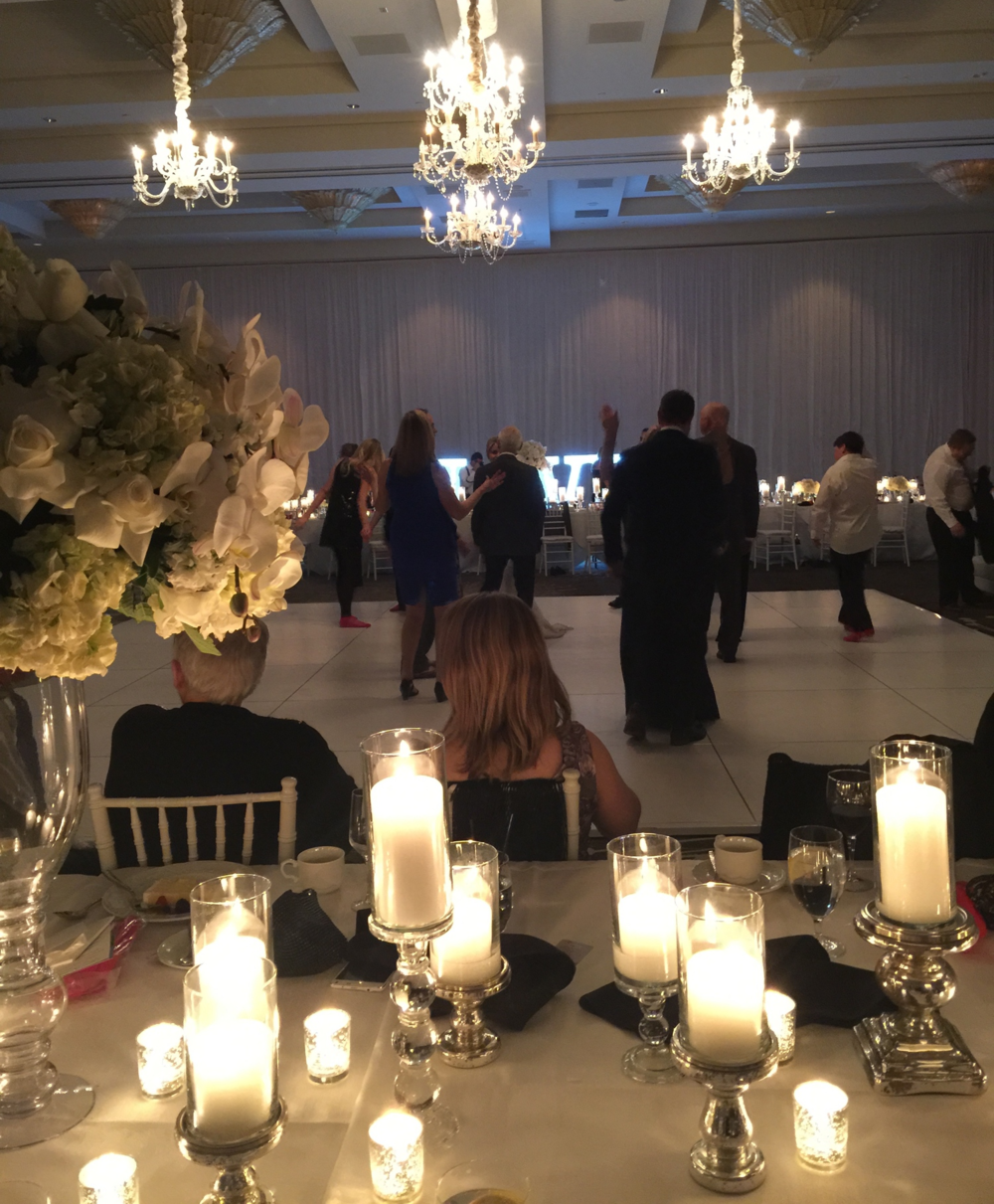Guests took to the dance floor, celebrating our newlyweds and enjoying the final moments of 2014.   Photo by   Andrea Eppolito.