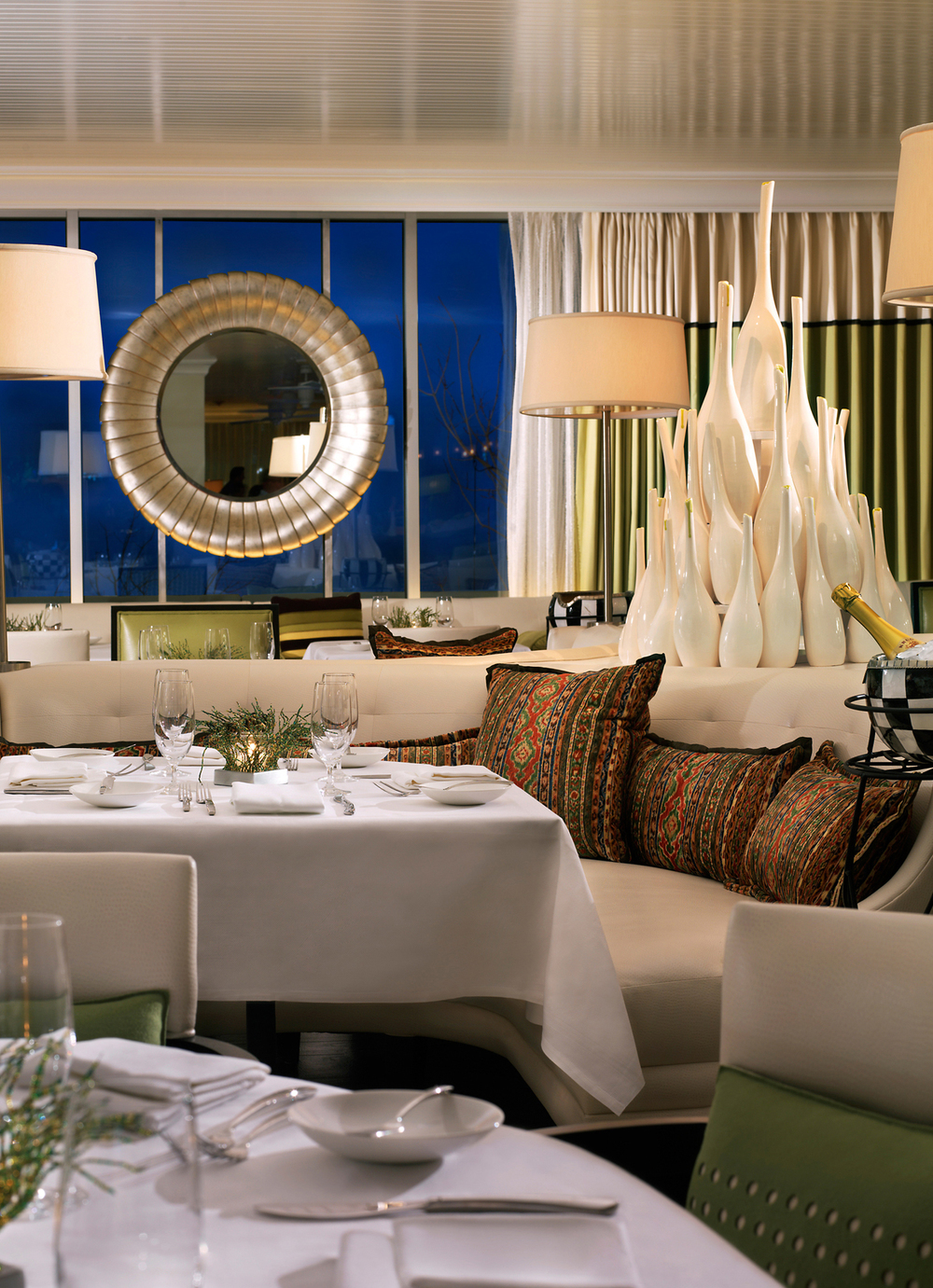 The dining room at Vintner Grill is all dreamy, creamy neutrals with pops of greens and shades of gold.
