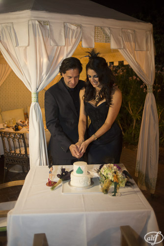 Cutting the cake in the courtyard of Vintner Grill.