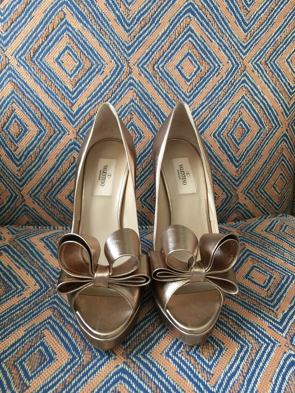 Beautiful gold wedding shoes with bows by Valentino.