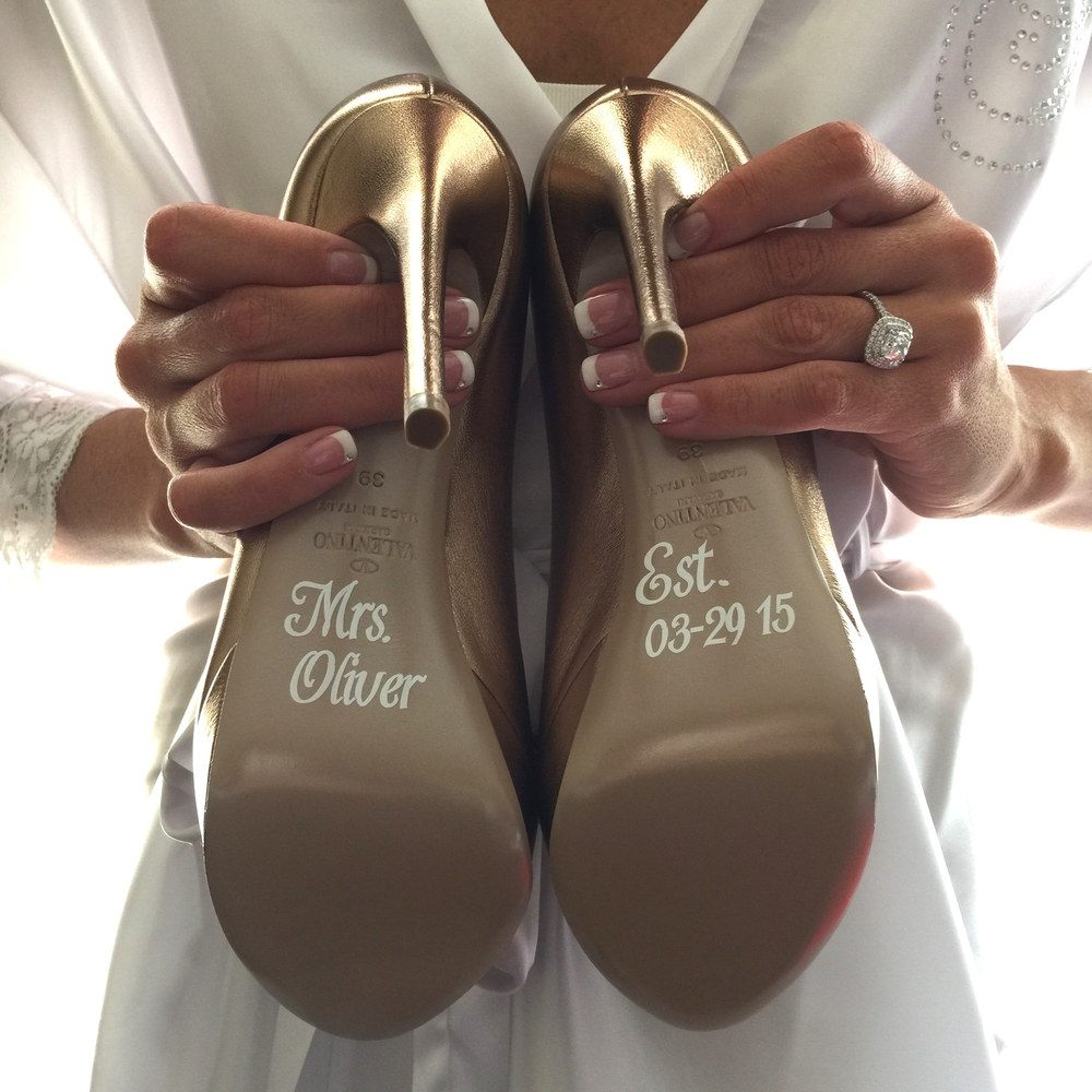 "Personalized soles read ""Mrs. Oliver"""