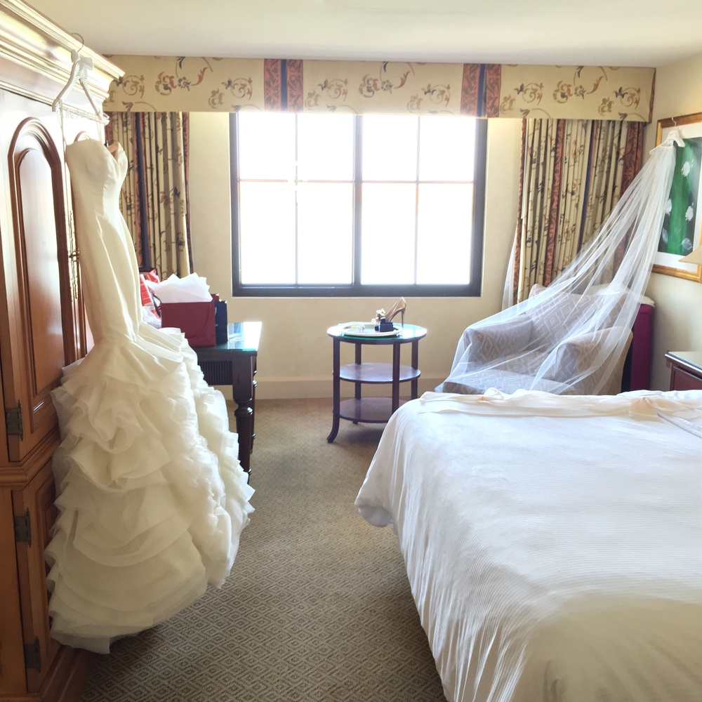 The calm before the storm!  The bride's wedding gown, veil, shoes and accessories were carefully laid out before the bridal party arrived.