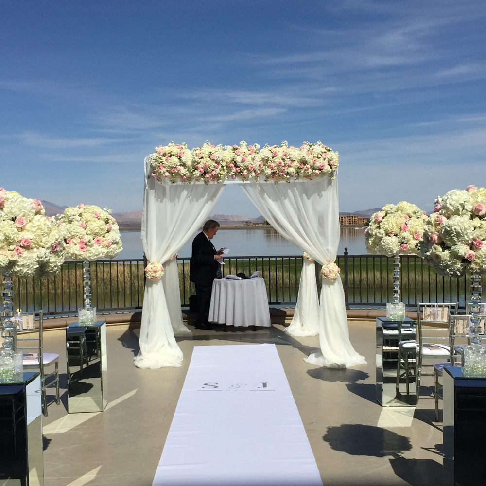 Rabbi Mel Hecht prepared the Chuppah for the interfaith ceremony on Lotus Court at The Westin Lake Las Vegas.  Flowers by Naakiti Floral.