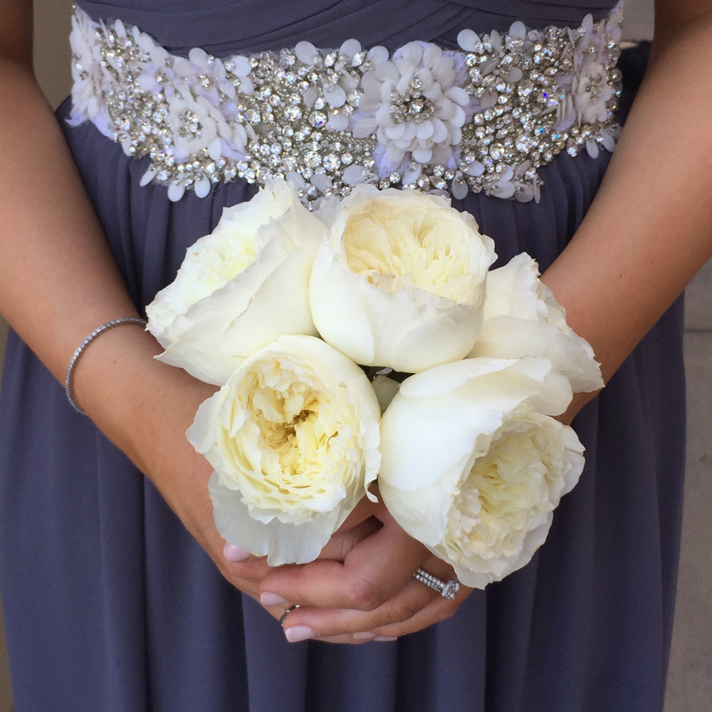 The Maid of Honor carried a small hand-tied bouquet of ivory garden roses, courtesy of Naakiti Floral.