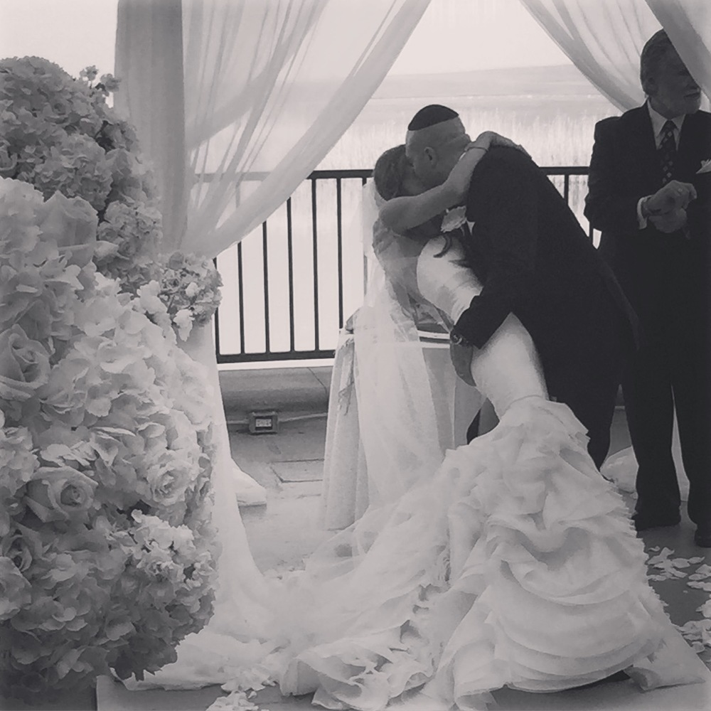 I love this photo of the bride and groom's first kiss.   It's a little grainy, a little moody, and a whole lotta sexy!