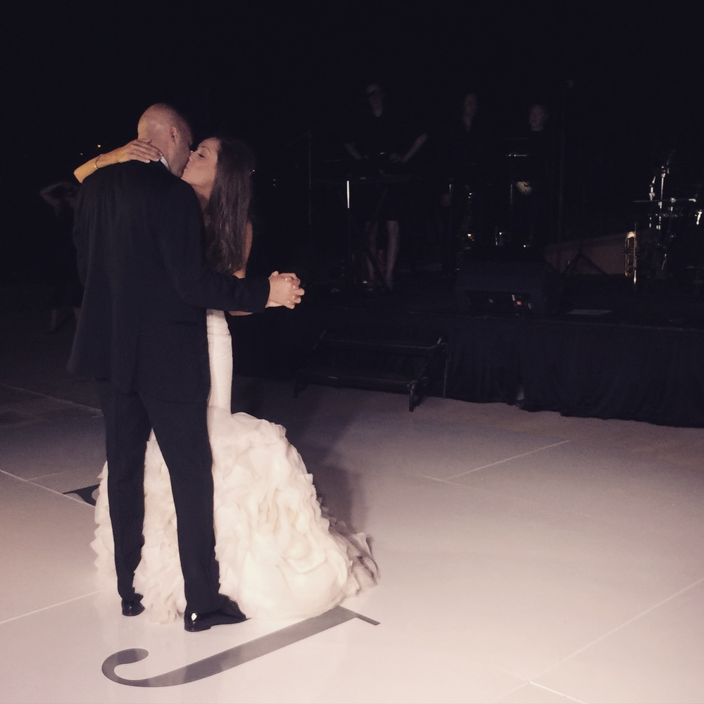 The first dance took place on a white dance floor topped with the couple's monogram in a steel grey.