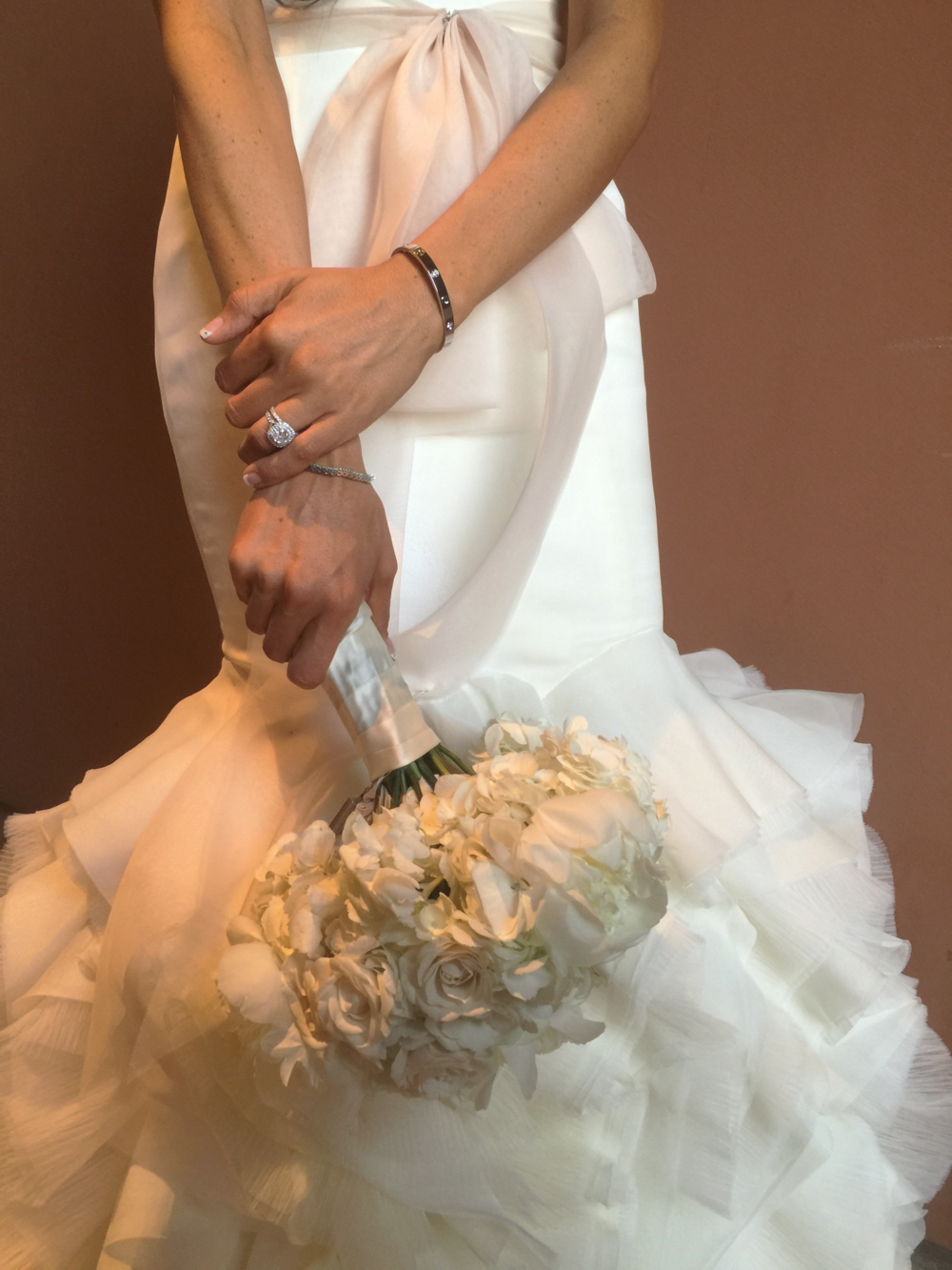 The bride's bouquet was just gorgeous!  And her new Cartier Love Bangle was just glimmering on her wrist!