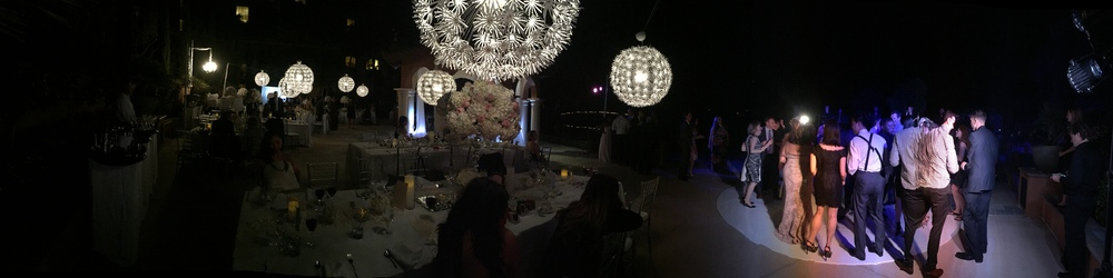 Oh, what a night!  A panoramic view of the reception filled with big white lights and a packed dance floor!