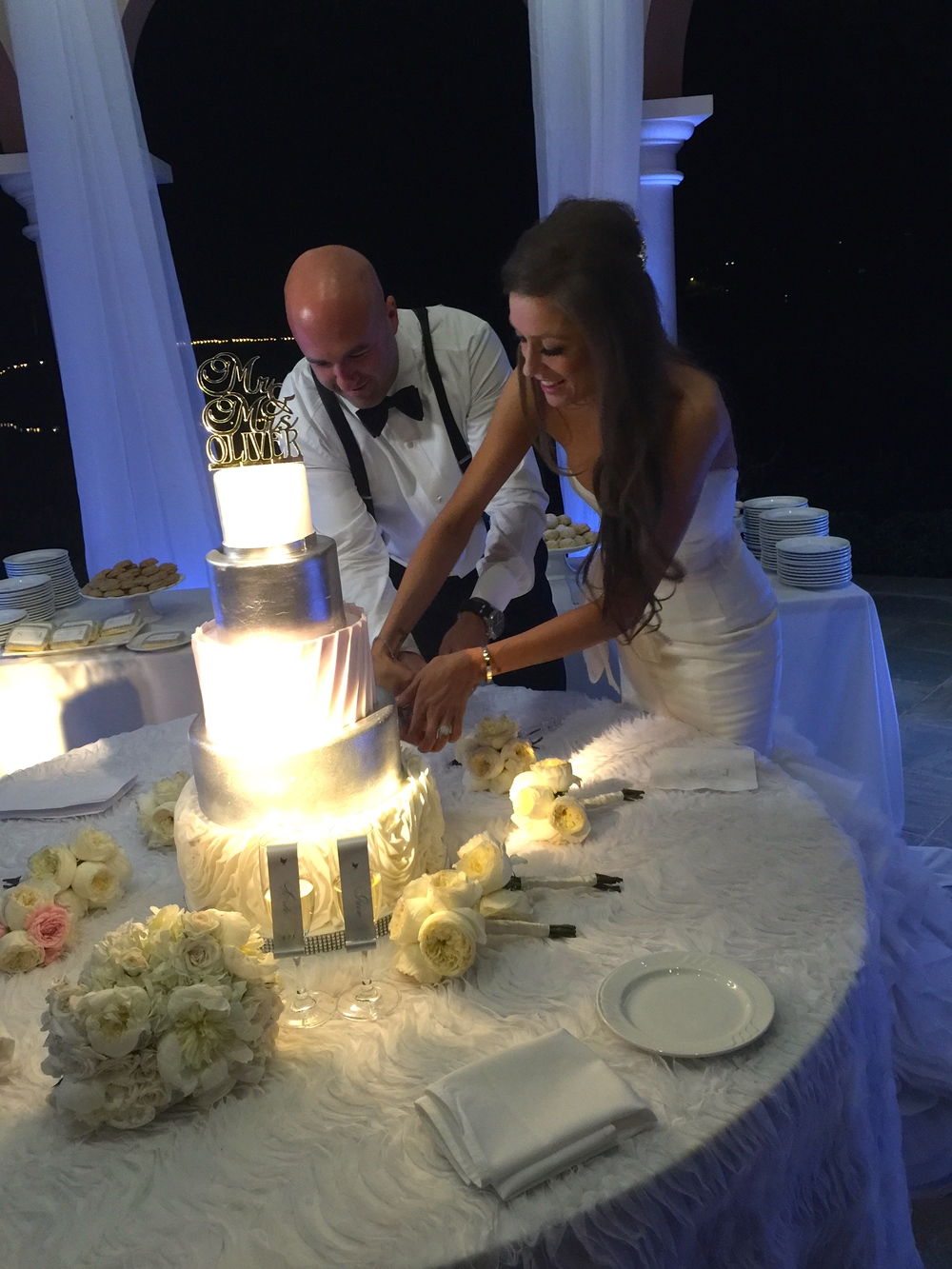 The cutting of the cake, made by Peridot Sweets.