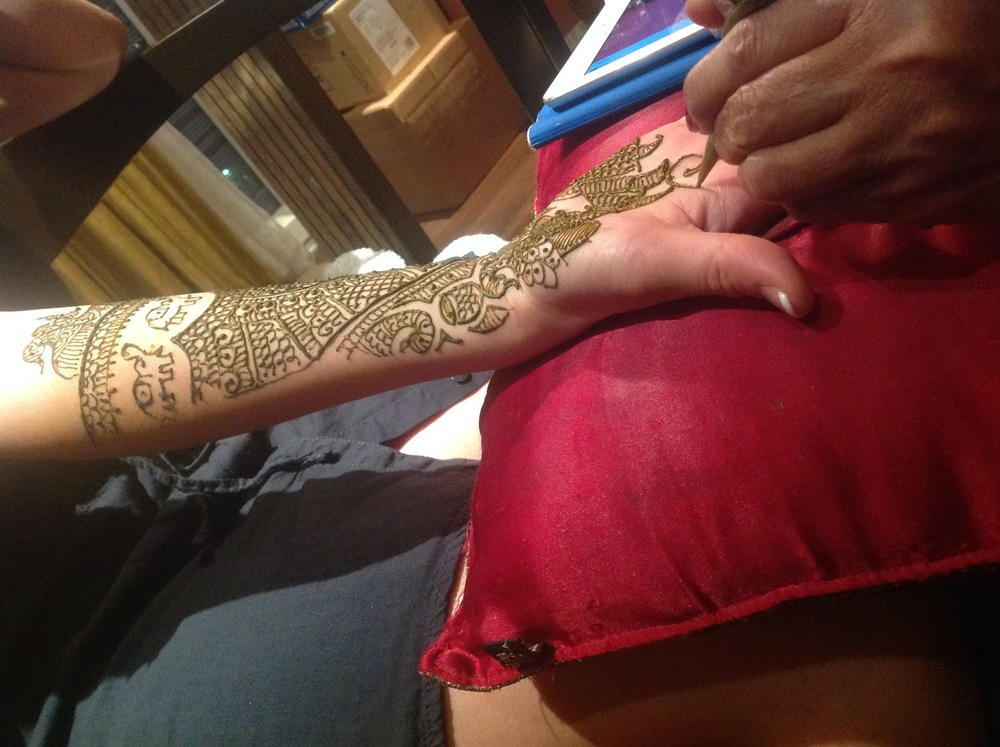 Traditional henna was applied to Patricia's hands, arms, feet, and legs to make her even more beautiful to the groom.