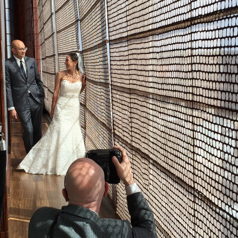 John Michael Cooper of Altf Photography taking formal portraits of the couple in Bar Mandarin Oriental.